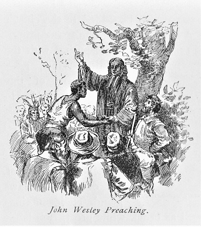 John Wesley, a Christian minister whose brother founded the Methodist Church, preaches in Colonial America in the 18th Century. Illustration published in The New Eclectic History of the United States by M. E. Thalheimer (American Book Company; New York, Cincinnati, and Chicago) in 1881 and 1890. Copyright expired; artwork is in Public Domain.