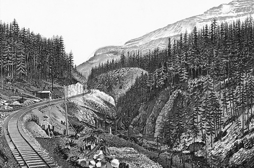 Kicking Horse Pass in the Canadian Rockies of Alberta, Canada. Vintage etching circa late 19th century. Alberta became a province in 1905, until then it was part of the Northwest Territories.