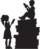 Two children reading on a stack of books. Click below for more kids stuff.