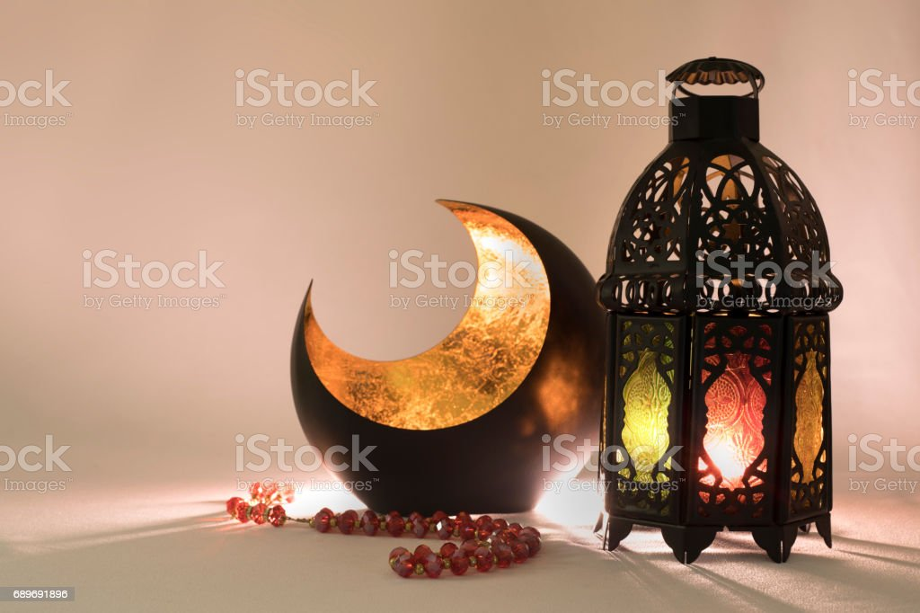 Lantern and a copper crescent in a low light vector art illustration