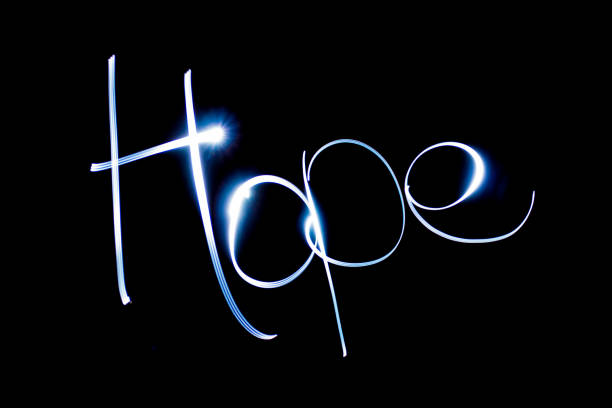 ilustrações de stock, clip art, desenhos animados e ícones de light painting the word hope. - hope