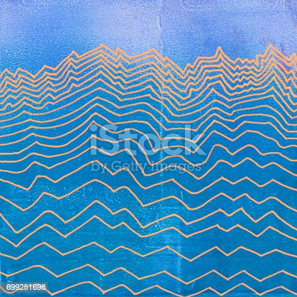 Line art hand painted with opaque orange paint. The illustration is on an opaque acrylic background with textures and mottled shades of blue. The pattern represents a mountain range or electrical waves.