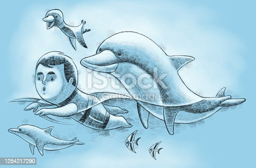 istock little boy swimming with dolphins 1254217290