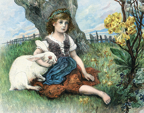 Little girl at Eastern day dreaming sitting with rabbit in nature
