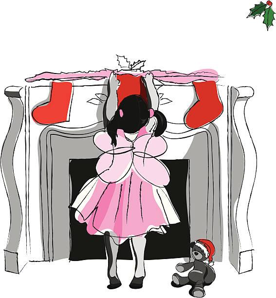 kleines mädchen hängen stocking am kamin - kaminverkleidungen stock-grafiken, -clipart, -cartoons und -symbole