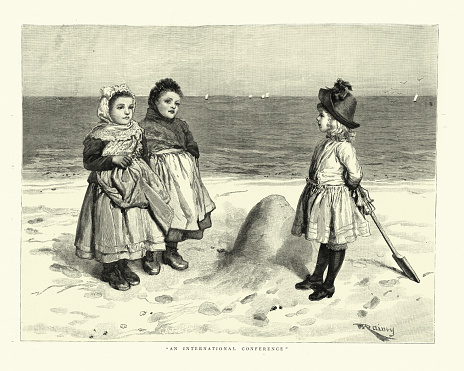 Little girls from different countries playing on the beach, Victorian 1880s