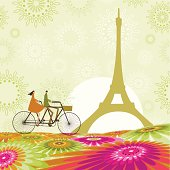 Couple of lovers cycling in Paris in spring.