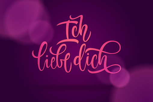 I love you lettering in German. Calligraphy on a dark violet background for cards, confession of love, invitations and banners. Modern brush calligraphy.
