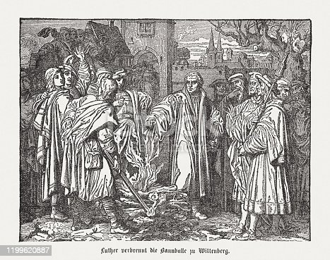 Martin Luther burns the papal bull at Wittenberg (In front of the Elstertor in Wittenberg, December 10, 1520). Wood engraving after a drawing (ca. 1870) by Josef Mathias Trenkwald (Austrian painter, 1824 - 1897), published in 1883.