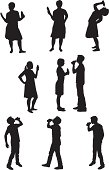 Male and female silhouettes drinking