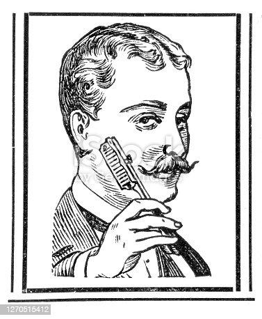 istock Man cutting beard with razor blade 1899 1270515412