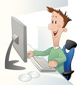 Happy young man in front of computer screen