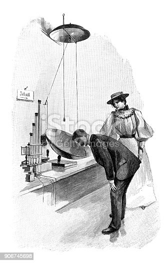 Man leans over the sound waves device. The woman next to him looks with interest at him - 1896