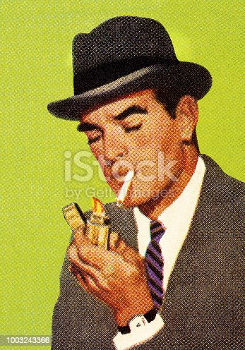 istock Man Lighting a Cigarette 1003243366
