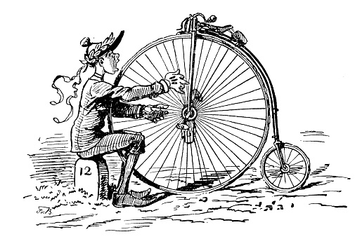 Man plucking the song of joy of the penny farthing bicycle