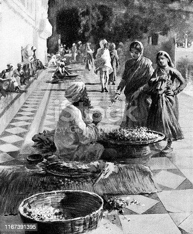 Man selling flowers at Harmandir Sahib Golden Temple in Amritsar, India during the British Raj era (circa late 19th century). Vintage etching circa late 19th century.