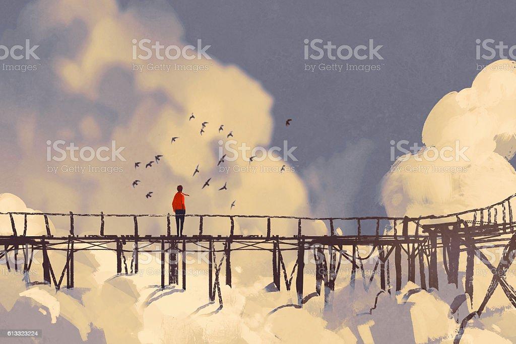 man standing on old bridge in clouds vector art illustration
