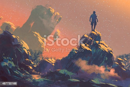 istock man standing on top of the hill watching the star 487730166