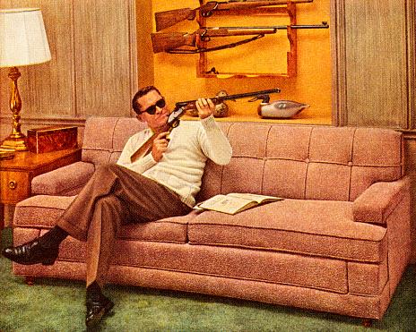 Man Wearing Sunglasses and Holding Gun