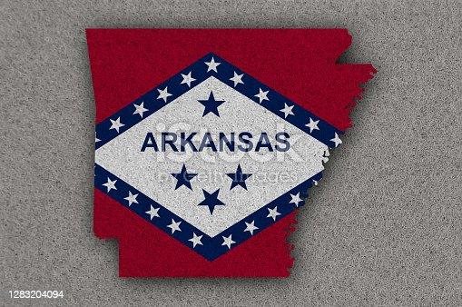 istock Map and flag of Arkansas on felt 1283204094