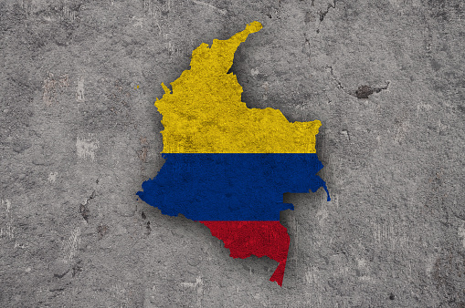 Map and flag of Colombia on weathered concrete