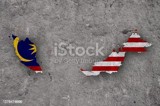 Map and flag of Malaysia on weathered concrete