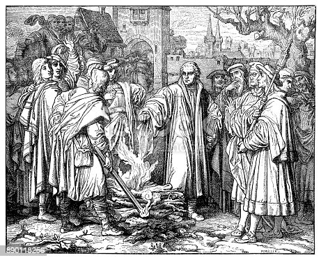 Illustration of a Martin luther burns the papal bull in Wittenberg. This illustration appeared in Gottfried's Historical Chronicle in 1619. The so-called