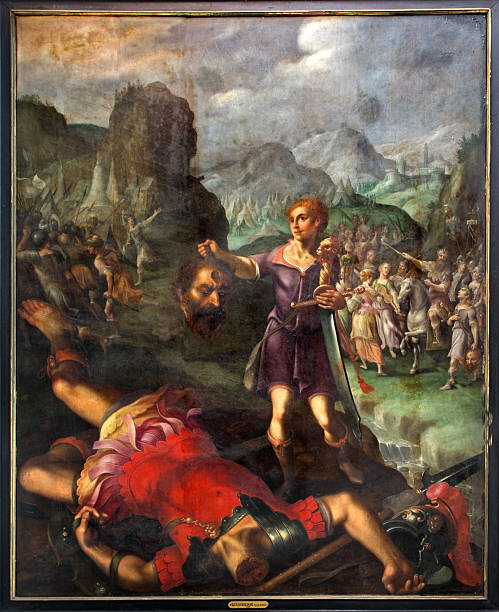 mechelen - david and goliath scene. - salud stock illustrations
