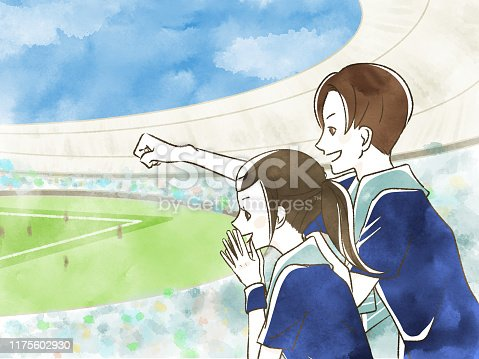 Man and woman watching sports at the stadium