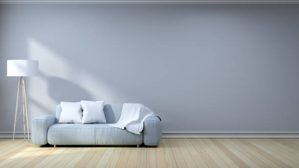 istock minimalist interior designlight gray sofa with lamp on gray wall and hardwood flooring mozeypictures Images