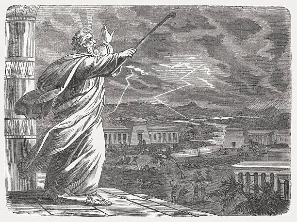 """Moses and the Seventh Blow (Exodus 9, 22-26), published 1877 """"When Moses extended his staff toward the sky, the Lord sent thunder and hail, and fire fell to the earth; so the Lord caused hail to rain down on the land of Egypt. Hail fell and fire mingled with the hail; the hail was so severe that there had not been any like it in all the land of Egypt since it had become a nation. The hail struck everything in the open fields, both people and animals, throughout all the land of Egypt. The hail struck everything that grows in the field, and it broke all the trees of the field to pieces.(Exodus, Chapter , 23-25). Woodcut after a drawing by Julius Schnorr von Carolsfeld (German painter, 1794 - 1872) from my archive, published in 1877."""" forked lightning stock illustrations"""