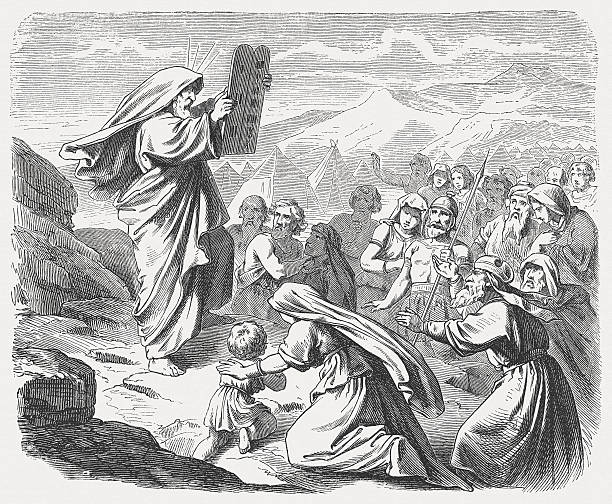 """Moses with the New Tablets (Exodus 34, 29-33) """"Now when Moses came down from Mount Sinai with the two tablets of the testimony in his hand aa when he came down from the mountain, Moses did not know that the skin of his face shone while he talked with him. When Aaron and all the Israelites saw Moses, the skin of his face shone; and they were afraid to approach him. But Moses called to them, so Aaron and all the leaders of the community came back to him, and Moses spoke to them. After this all the Israelites approached, and he commanded them all that the Lord had spoken to him on Mount Sinai. When Moses finished speaking with them, he would put a veil on his face. (Exodus, Chapter 34, 29-33). Woodcut after a drawing by Julius Schnorr von Carolsfeld (German painter, 1794 - 1872) from my archive, published in 1877."""" huangpu district stock illustrations"""