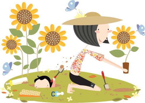 Mother Gardening with Son Digging Hole