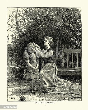 istock Mother putting flowers in her daughters hair, Victorian 1279639352
