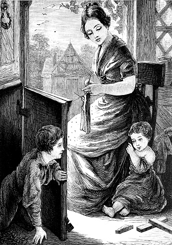 Mother sitting on chair knitting, boy and girl playing around her