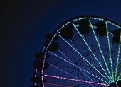 Detailed night ferris wheel background with copy space.