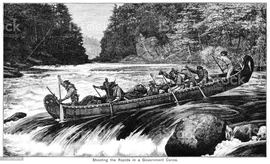 Passengers being conveyed over the rapids of a Canadian river in a...