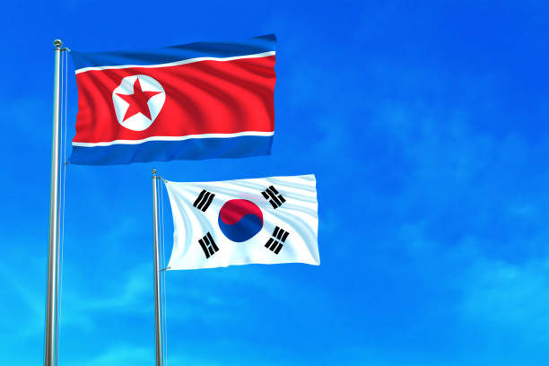 bildbanksillustrationer, clip art samt tecknat material och ikoner med north and south korea flags on the blue sky. - norr