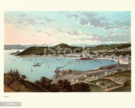 Vintage engraving of Oban, Scotland in the 19th Century. A resort town within the Argyll and Bute council area of Scotland. Oban occupies a setting in the Firth of Lorn. The bay is a near perfect horseshoe, protected by the island of Kerrera