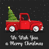 istock Old vintage red Christmas truck with pine tree 1288515066