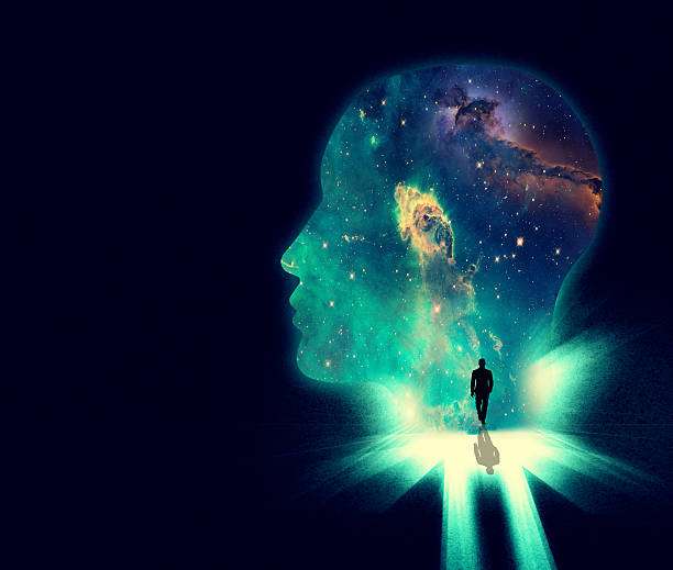 Open your mind the the wonders of the universe Illustration of a man walking towards a huge shape of a person's head overlaid with an image of the cosmos dreamlike stock illustrations