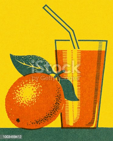 Orange and Glass of Orange Juice
