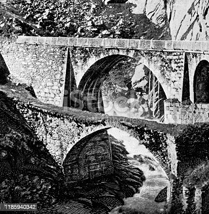 The original first (foreground 1595) and second (background 1833) Devil's Bridges at Schollenen Gorge in Uri Canton, Switzerland. Vintage halftone etching circa late 19th century. The original 16th century arch bridge collapsed in 1888. A third bridge was built above the second in 1958.