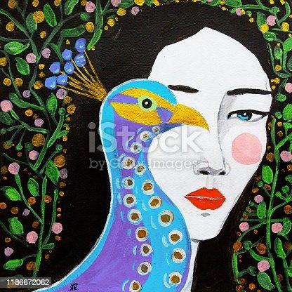 Beautiful girl with a fairy bird