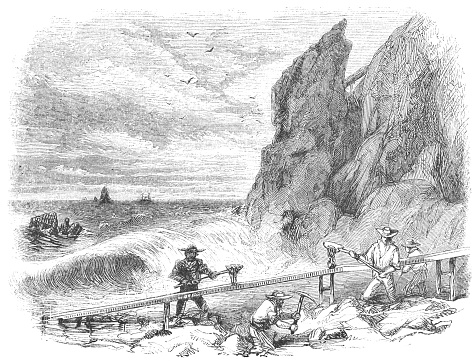 Panning for gold at Gold Bluffs Beach (Prairie Creek Redwoods State Park) in Humboldt County, California, United States of America (circa mid 19th century). Vintage etching circa mid 19th century.
