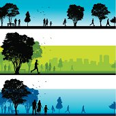 Silhouetted people walking in park in three different landscape scenes.