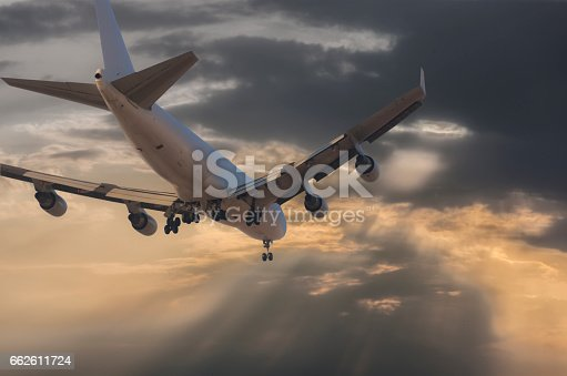 155439315istockphoto Passenger plane flying against sunset 662611724
