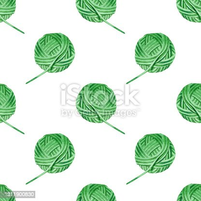 istock Pattern with green balls of thread. The theme of the hobby of knitting and crocheting. Watercolor hand-drawn illustrations on a white background. For handmade craftsmen, for knitters blog design. 1311900830