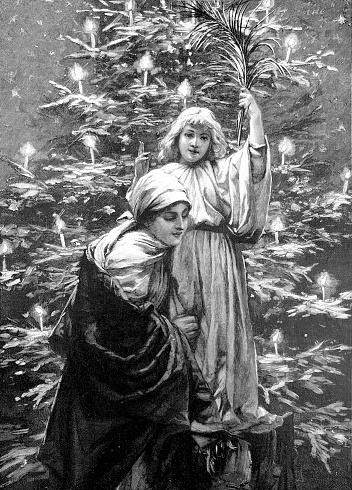 Peace symbol: Mother and daughter standing at Christmas tree