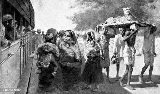 People boarding the third class section of a train in Jodhpur, India during the British Raj era (circa late 19th century). Vintage etching circa late 19th century.